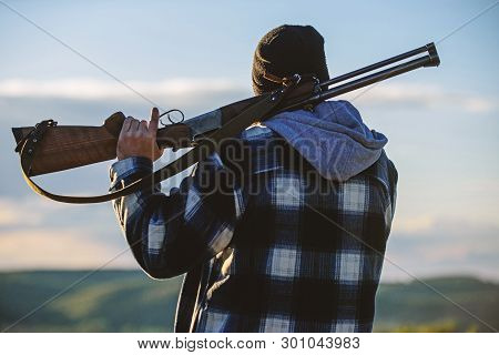 Hunting Masculine Hobby Leisure Concept. Brutality And Masculinity. Hunter Carry Rifle Gun On Should