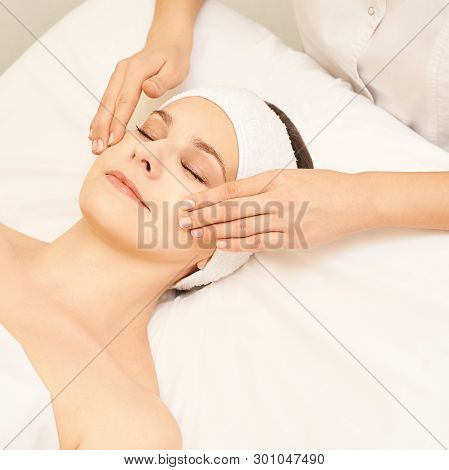 Woman face cosmetology treatment. Biorevitalization skin therapy. Doctor insert filler. Girl clinic facial mesotherapy. Injecting in medical salon. poster