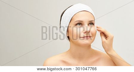 Cosmetology Doctor Remove Mascara From Girl Face. Cotton Pad With Woman Hands. Demakeup Lotion