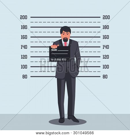 Portrait Of Criminal. Arrested Photo. Guilty Businessman In Police Station, Sign In Hand On Criminal
