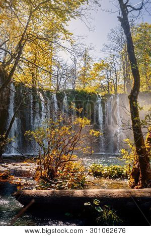 Waterfalls And Trees Of Beautiful Plitvicka Lakes Lit By Sun Rays.