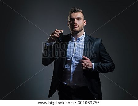 Masculine Perfume. Fragrance. Male Fragrance And Perfumery, Cosmetics. Man Holding Up Bottle Of Perf