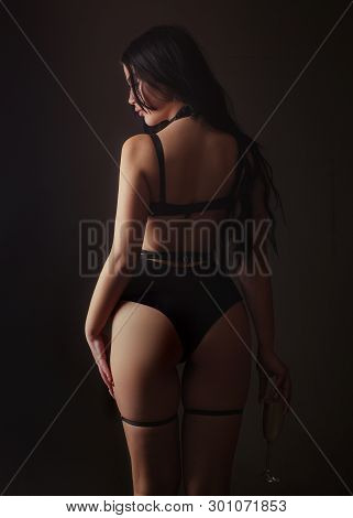 Slim Woman Dressed In Black Lingerie And Tied With Ropes. Female In Sexy Bikini. Lingerie Sexy Girl