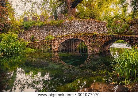 Dreamlike Medieval Fantasy Forest Landscape River Bridge .