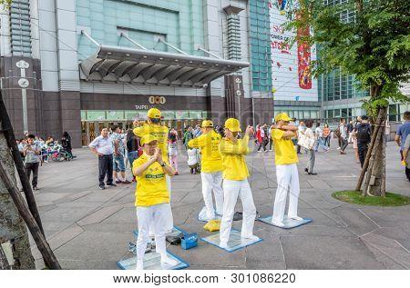 Taipei, Taiwan - May 12th, 2019:Falun Gong members stand at the square near 101 skyscraper in Taipei, Taiwan, Asia