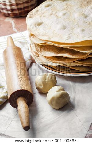 Cooking Multi-layered Cake Napoleon - Baked Cake Layers, Raw Dough And Wooden Rolling Pin