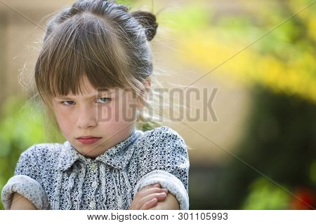 Pretty Funny Moody Young Child Girl Outdoor Feeling Angry And Unsatisfied On Blurred Summer Green Ba