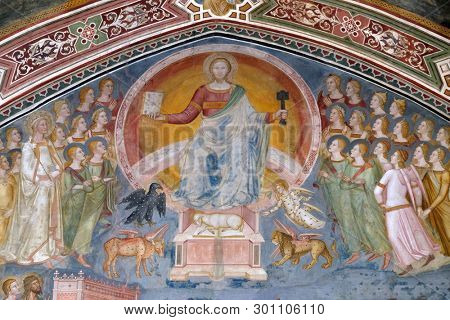 FLORENCE, ITALY - JANUARY 10, 2019: Christ in Glory, from the fresco of The Church Militant and Triumphant, by Andrea di Buonaiuto, Spanish Chapel in Santa Maria Novella church in Florence, Italy