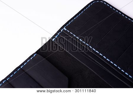 A Part Of Handmade Black Leather Porte-monnaie Isolated On White Background. Stock Photo Of Luxury A