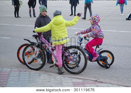 Syktyvkar,komi/ Russia, April 14,2019/children Repent On A Bicycle On The City Street.