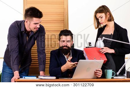 Work Hard Play Hard. Successful Business Men And Woman Using Computer For Work. Professional People
