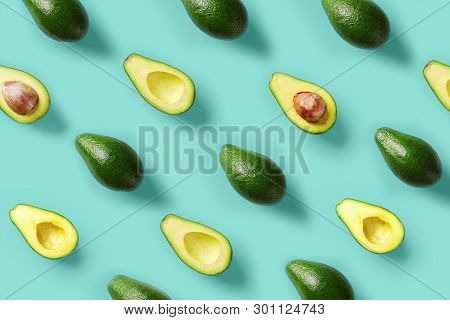 Avocado Pattern On Blue Background. Pop Art Design, Creative Summer Food Concept. Green Avocadoes, M