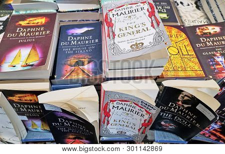 Cornwall, England - Aug 2016: Closeup Of A Table Of Books In A Shop Selling Daphne Du Maurie Paperba