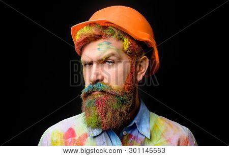 Bearded Man In Dirty Paint Shirt In Construction Helmet. Business, Building, Industry, Technology -