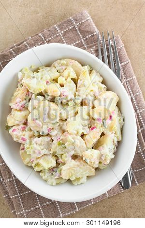 Fresh Homemade Vegetarian Potato Salad Made With Red Onion, Pickles, Mayonnaise And Mustard, Served