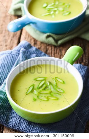 Cream Of Green Asparagus Soup In Two Bowls, Garnished With Sliced Asparagus On Top (selective Focus,