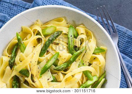 Fresh Homemade Pasta Dish Of Fettuccine Or Tagliatelle, Green Asparagus, Garlic And Lemon Juice In B