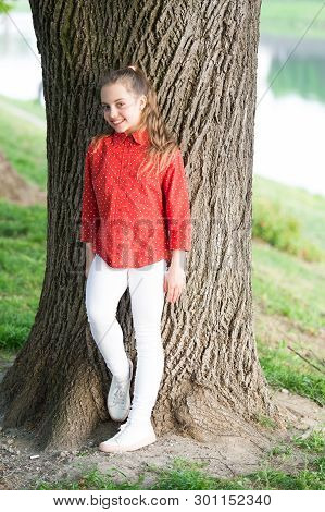 Girl Little Cute Child Enjoy Peace And Tranquility At Tree Trunk. Place Of Power. Peaceful Place. Fi