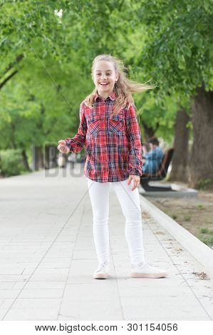 Hairstyles To Wear On Windy Days. Windproof Hairstyles. Girl Little Cute Child Enjoy Walk On Windy D