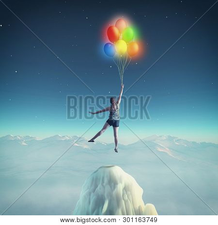 Woman Flying With Colorful Balloons In The Night. The Concept Of Accomplished Dreams.