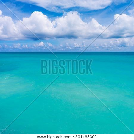Tranquil Tropical Water Seascape with Sandy Sea Floor. Exotic Turquoise Sea Water Backdrop.