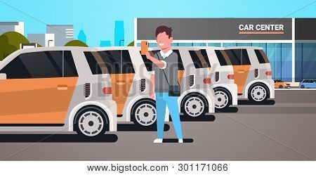 Young Man Choosing Vehicle On Car Center Parking Using Mobile Application Carsharing Concept Guy Hol