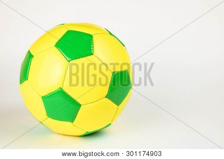Yeallow And Gree Football Ball. Classic Soccer Ball.