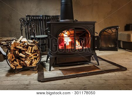 burning wood in the stove in a country house
