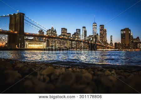Panorama Of Downtown Manhattan And The Brooklyn Bridge At Night From Brooklyn In Nyc