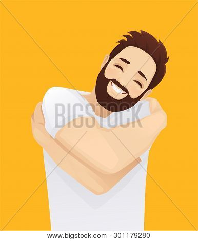 Happy Handsome Smiling Man Hugging Himself With Enjoying Face Isolated On Yellow Background. Love By
