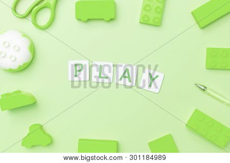 Play Concept With Toy And Objects For Child Education Concept On Green Background