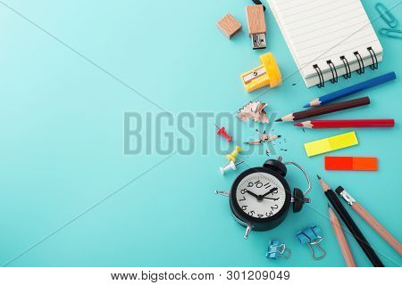 School Supplies With Clock On Blue Background