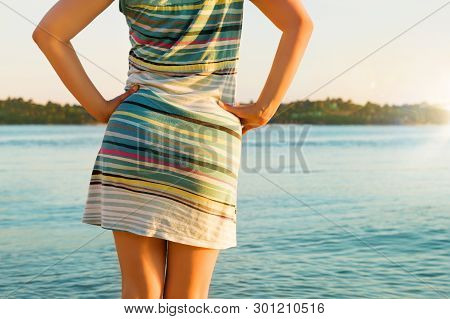 Beautiful Girl In Colorful Dress Backview In Front Of Ocean And Tropical Island. Enjoying Vacation I