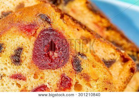 Macro Image Of A Cake Slice Fruits. Fruitcake With Raisin And Cherry. Dessert. Close-up Of Sweet Muf