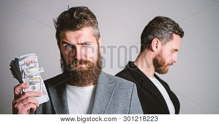 Scam And Deception. Man Bearded Fraudster Hold Cash Money While Victim Stand Sad Background. While N