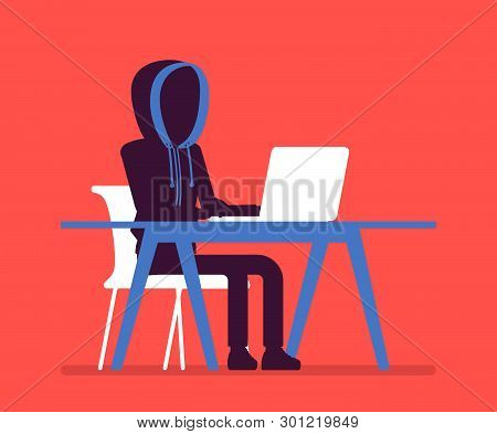 Anonymous Man With Hidden Face At Laptop. Hacker Dark Abstract Body, Covered With Hood, Online Perso