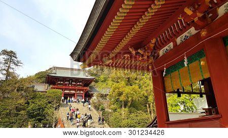 Kamakura, Japan - 19 April, 2019: People Walking In The Tsurugaoka Hachimangu. The Temple Is The Mos