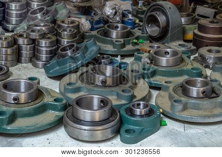 Pile Of Dusty Bearings In A Storage Room Of A Factory.