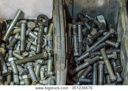 Metal Screws And Steel Bolts In A Storage Room Of A Factory.