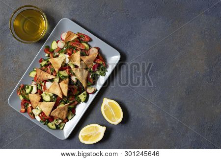 Traditional Fattoush Salad  With Vegetables And Pita Bread. Levantine, Arabic, Middle Eastern Cuisin