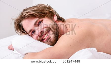 Morning Routine Tips To Feel Good All Day. Man Handsome Guy Lay In Bed In Morning. Tips On How To Wa