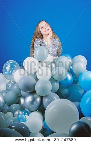 Planning Her Birthday Party. Thoughtful Little Child Waiting For Party Time. Small Child With Party