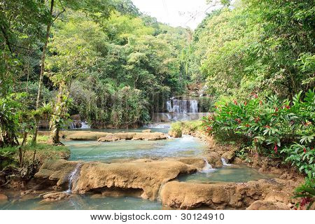 Waterfall in the middle of the rain forest in Jamaica poster
