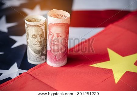 Us Dollar And Yuan Banknote On Usa And China Flags. Its Is Symbol For Tariff Trade War Crisis Betwee