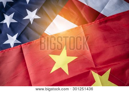 Usa Flag And China Flag With Sunlight For Tariff Trade War Between United States And China Who Confl