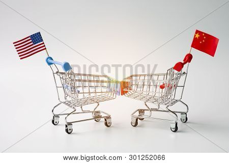 Closeup Shopping Cart With Usa And China Flag For Tariff Trade War Between United States And China W