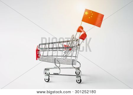 Closeup Of Empty Shopping Cart With China Flag On White Background. It Is Symbol Of China Trade Surp