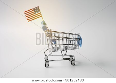 Closeup Of Empty Shopping Cart With Usa Flag On White Background. It Is Symbol Of Usa Trade Surplus