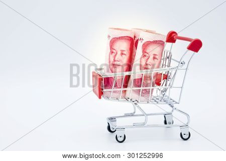 Closeup Shopping Cart With China Yuan Banknote On White Background.china Have Global Surplus Deficit