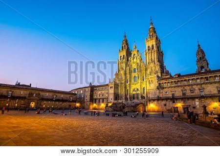 Santiago De Compostela , Spain - May 12, 2019: Tourists And Pilgrims Roam The Streets Where Magnific
